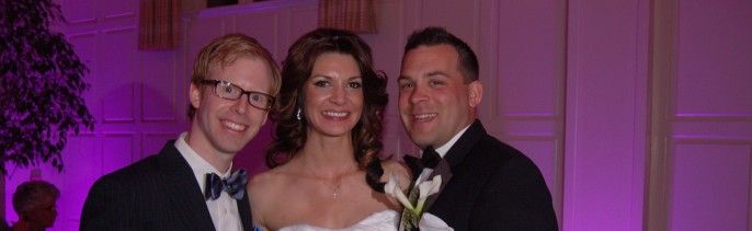 Greg with a happy Bride and Groom